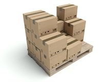 Cardboard boxes on wooden palette  on white Royalty Free Stock Image
