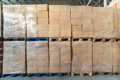 Cardboard boxes wrapped in stretch film. Stock Image