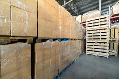 Cardboard boxes wrapped in stretch film. Stock Images