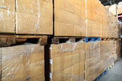 Cardboard boxes wrapped in stretch film. Royalty Free Stock Photo