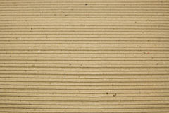 Cardboard brown striped background Stock Images