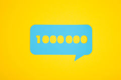 The cardboard bubble with one million number. The blue cardboard bubble with the one million number on the yellow background from above vector illustration