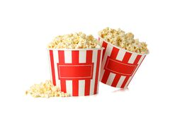 Cardboard buckets with popcorn isolated on background
