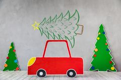 Cardboard car and Christmas tree Royalty Free Stock Photo