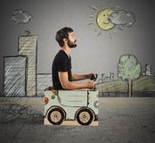 Cardboard car in drawing city Stock Photos