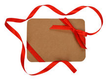 Cardboard card decorated with red ribbon Stock Photography