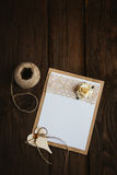 Cardboard card with flower. The basis for the writing on the brown wooden table in retro style hand made paper rose Stock Images