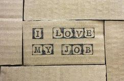 Cardboard card with words I Love My Job Stock Photography