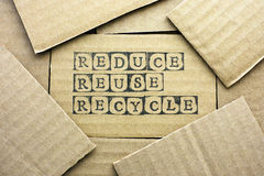 Cardboard card with words Reduce Reuse Recycle Stock Images
