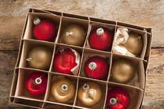Cardboard carton of red and gold Christmas balls Stock Photo