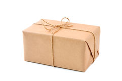 Cardboard carton wrapped with brown paper and cord Royalty Free Stock Photos