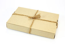 Cardboard carton wrapped with brown paper and tied with cord Royalty Free Stock Image