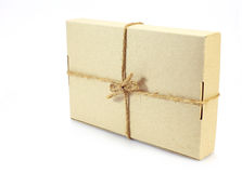 Cardboard carton wrapped with brown paper and tied with cord Royalty Free Stock Images