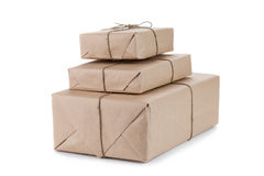 Cardboard carton wrapped with brown paper and tied with string Stock Image