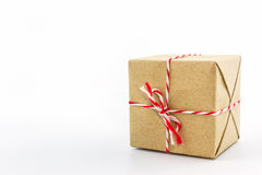 Cardboard carton wrapped with brown paper, tied with string. Royalty Free Stock Images