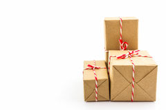 Cardboard carton wrapped with brown paper, tied with string. Stock Photo