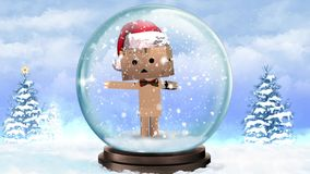 Cardboard Character in a Snow Globe with Present stock video footage