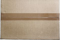 Cardboard. Closeup of packing tape on cardboard box Stock Image