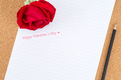 Cardboard, corkboard with note paper with pencil and rose beside Stock Photography