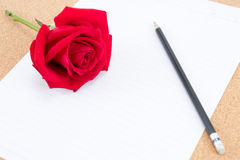 Cardboard, corkboard with note paper with pencil and rose beside Royalty Free Stock Photography