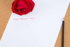 Cardboard, corkboard with note paper with pencil and rose beside Stock Photo