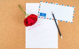 Cardboard, corkboard with note paper with pencil and rose beside Stock Image