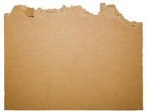Cardboard corners ripped end. The roughly ripped and jagged edges of cellulose brown cardboard removed from packing material form open space for text between the royalty free stock image