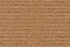 Cardboard Corrugated Grunge Texture. Photograph of recycle brown corrugated, coarse grain, striped, grooved, cardboard, grunge texture sample stock photography