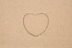 Cardboard corrugated with a heart shape cut out Stock Images