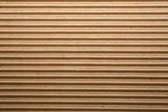 Cardboard corrugations tan background Stock Images