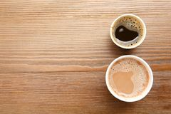 Cardboard cups of coffee on wooden table, top view stock photos
