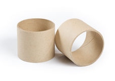 Cardboard cylinders. On a white background Royalty Free Stock Photography