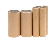 Cardboard cylinders. Row of cardboard cylinders on a white background Royalty Free Stock Photography