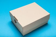 Cardboard delivery box, fragile beige corrugated stock photo