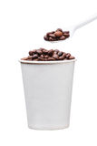 Cardboard disposable cup with coffee and spoon on white background Stock Photos