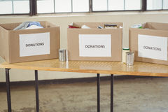 Cardboard donation boxes on table Stock Image