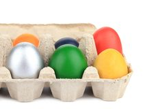 Cardboard egg box with colorful eggs. Royalty Free Stock Photos
