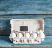 Cardboard egg box on wooden table Royalty Free Stock Photography