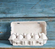 Cardboard egg box on wooden table Royalty Free Stock Photos