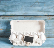 Cardboard egg box on wooden table Stock Photo