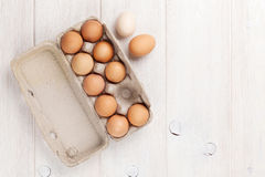 Cardboard egg box on wooden table Royalty Free Stock Image