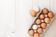 Cardboard egg box on wooden table Royalty Free Stock Images