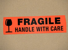 Cardboard - Fragile Handle with car Royalty Free Stock Photos