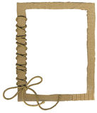 Cardboard frame for photos with a rope bow Royalty Free Stock Photo