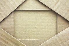 Cardboard frame with piece of cardboard. Full frame stock image