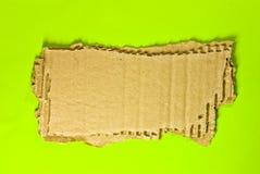 Cardboard on green Stock Image