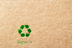 Cardboard with green recycle symbol Stock Photo