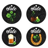 Cardboard hanging price stickers for St. Patrick s Day on the white background. Four cardboard hanging price stickers on St. Patrick s Day on white background Royalty Free Stock Photo