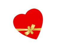 Cardboard heart bandaged golden ribbon bow isolated on white Royalty Free Stock Photo