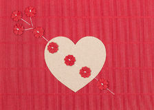 Cardboard heart with paper flower arrow Stock Images